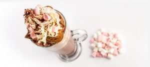 A Photograph of a Hot Chocolate Drink with marshmallows