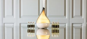 An image of a diffuser product on a reflective surface