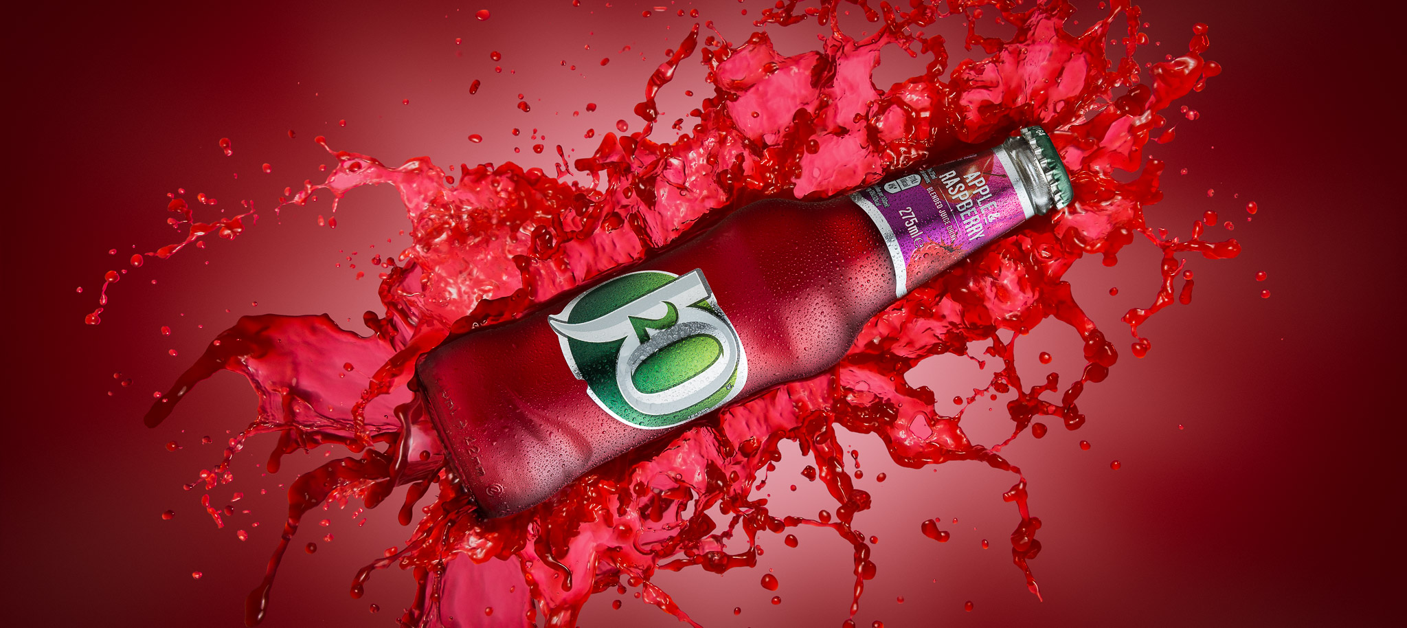 A bottle of J20 with splashes as an example of drinks photography